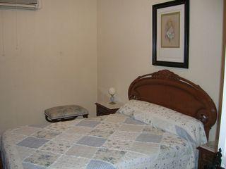 Dormitorio matrimonio madera clasico