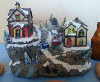 Carrusel de Navidad en cerámica. Diorama musical.