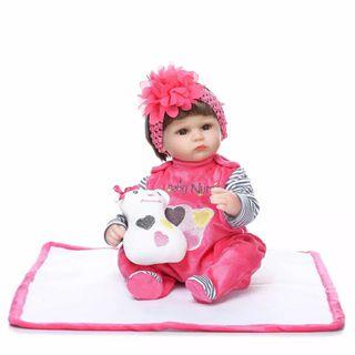Muñeca realista 40 cm con peluche