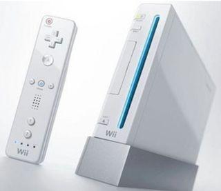 Wii blanca + 3 mandos + Nunchuk + volante+ juegos