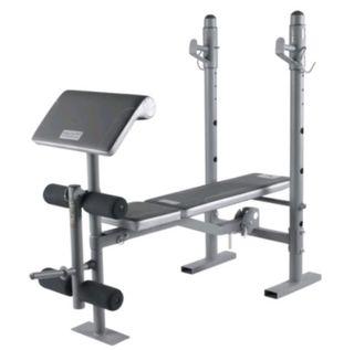 banco de pesas con barra y discos 20kg