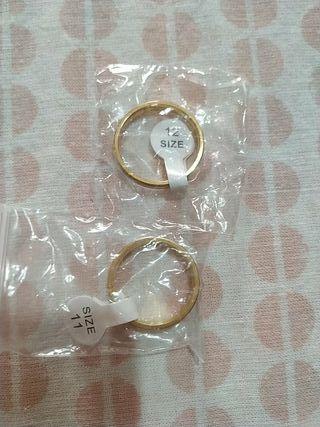 anillos de compromiso talla 12 hombre y 11 mujer
