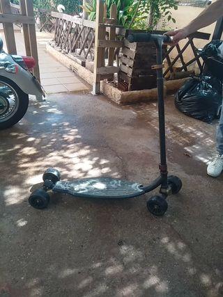 patinete tres cuatro ruedas