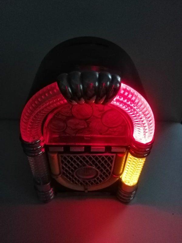 Hucha gramola con música y luz