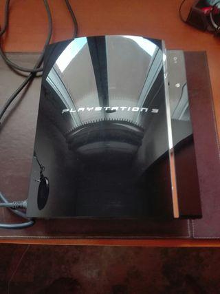 Playstation 3 con dos mandos y dos juegos