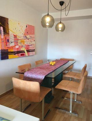 Mesa de comedor de cristal y 6 sillas