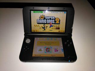 Nintendo 3DS XL, 4 juegos, tarjeta SD y fundas