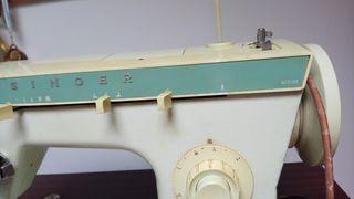 Maquína de coser marca singer antigua