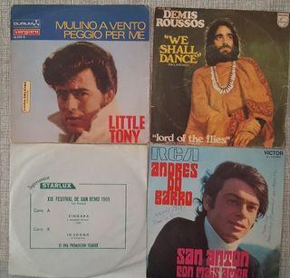 """4 discos de vinilo 7"""" variados."""