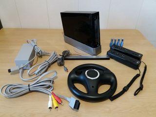 Consola Wii negra, accesorios y juegos