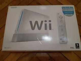 Wii completa con mandos adicionales y juego.