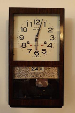 Reloj de pared Orient.