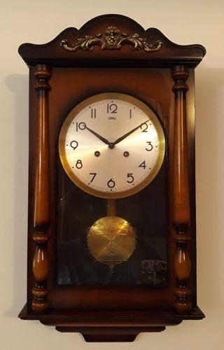Antiguo reloj de pared SARS