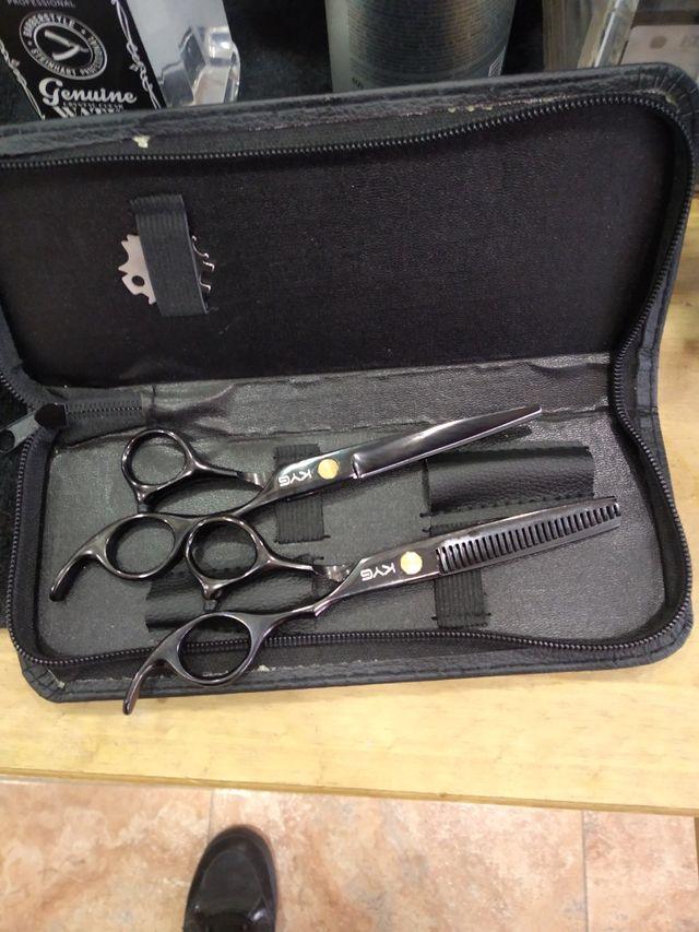 2 tijeras de peluqueria