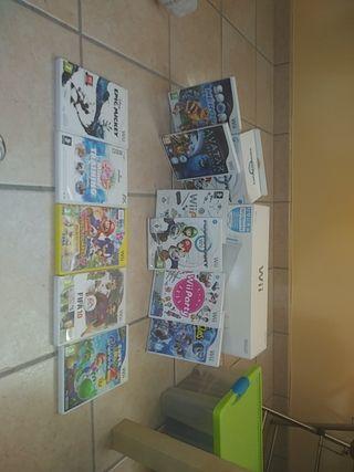Wii + 2 juegos + 2 mandos con jostick + volante