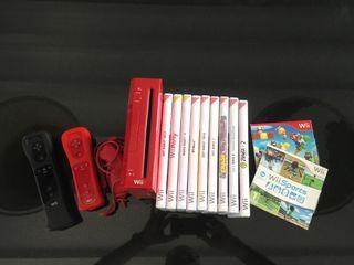 Consola Nintendo WI con varios juegos y accesorios
