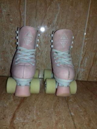 patines oxelo rosas talla 29