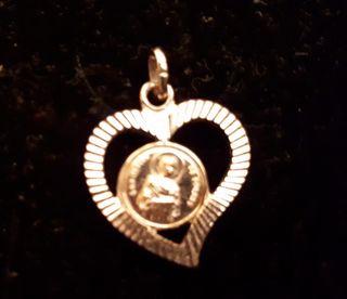 Medalla enmarcada en corazon