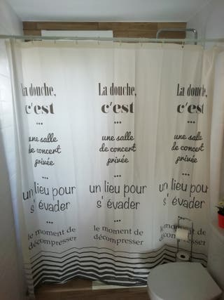 barra extensible y cortina baño