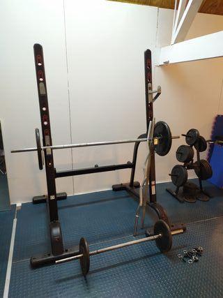 Juego de pesas, barras y rack para gimnasio