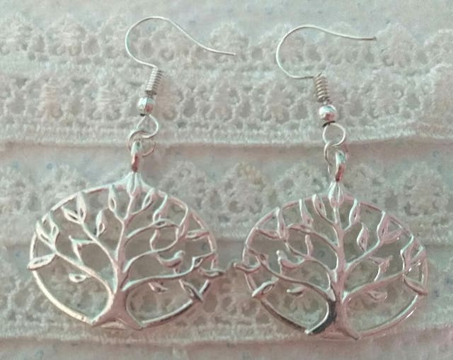 Bright silver coloured tree of life earrings