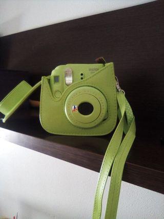 cámara de fotos instantaneas.con funda.intacta