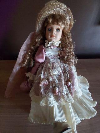 muñeca porcelana grande montada en columpio