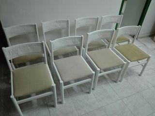 Juego de mesa extensible y ocho sillas