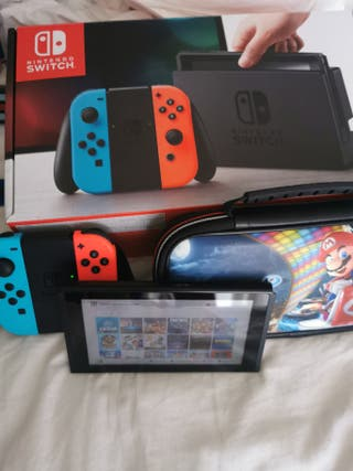 nintendo switch con funda original mario y 14 jueg
