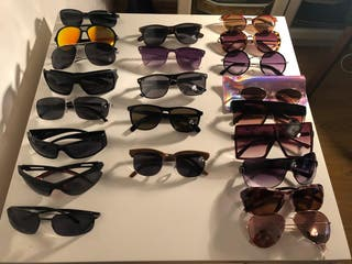 a whole lot of designer Sunglasses