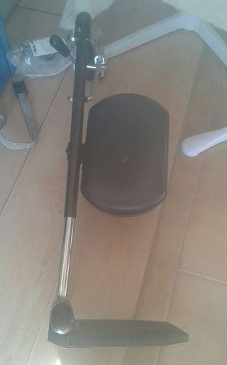 acople pierna para silla de ruedas.