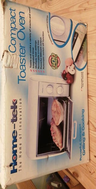 HOME-TEK COMPACT TOASTER OVEN USED TWICE
