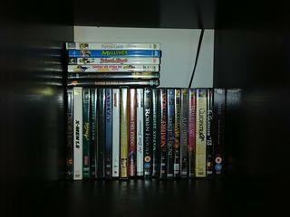colección dvd películas y reproductor
