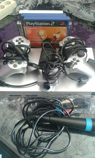 Playstation2 mas camara et 2 mecrofonos et mandos