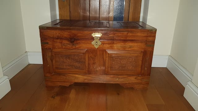 beutiful hand carved wooden trunk
