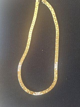 cadena de oro 18 kilates brillantes y oro blanco
