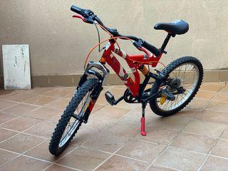 Bici infantil doble suspensión.