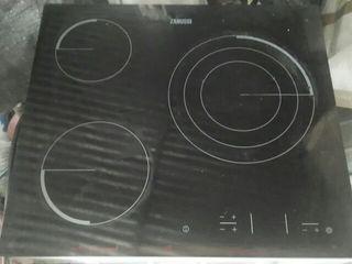 placa de inducción y horno en muy buen estado.