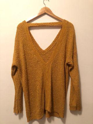 Suéter espalda descubierta