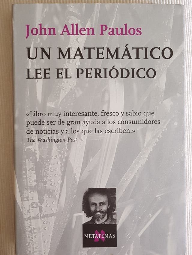 Un matemático lee el periodico