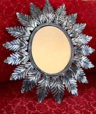 Antiguo espejo sol