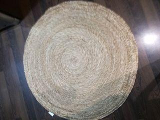 alfombra redonda de yute
