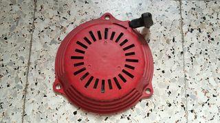 tirador de generador