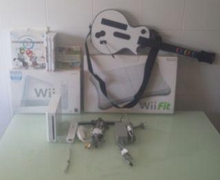 Nintendo Wii + Guitar Hero + Mario Kart + Wii fit