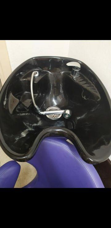 sillon de peluquería con lavabo