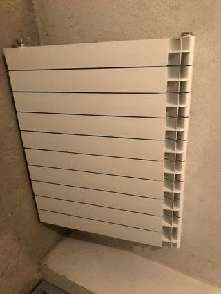 2 radiadores de aluminio de 10 elementos y 1 de 12