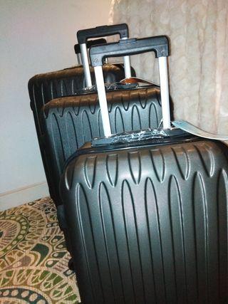 3 maletas color ceniza