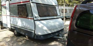 Caravana con ficha verde