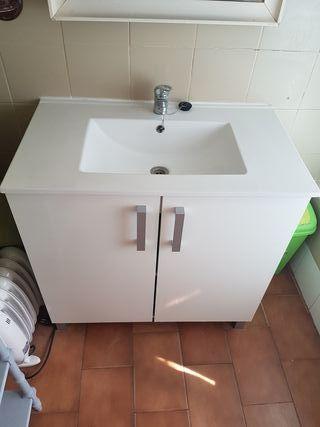 mueble lavabo y grifo
