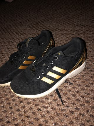 Adidas gold and black shoes